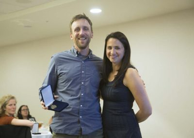 Erika Fleury presenting JB Mulcahy with a Leadership Award at the Recognition Dinner