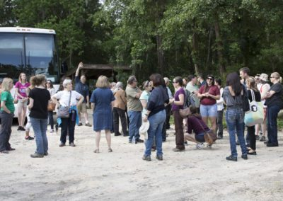 A tour group arrives at Jungle Friends Primate Sanctuary
