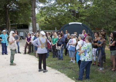 Kari Bagnall leads a group touring Jungle Friends Primate Sanctuary