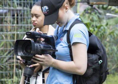 Journalists documenting the tour of Jungle Friends Primate Sanctuary